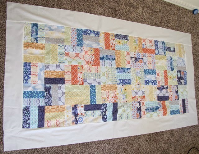 Jelly Roll Quilt - The Ribbon Retreat Blog