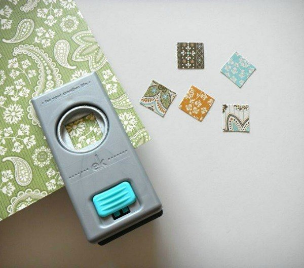 Cut out your scrapbook paper with your hole punch. Turn it upside down so you can see the image.