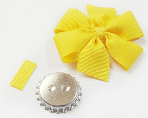 Use super glue to attach the bottle cap to the hair bow.