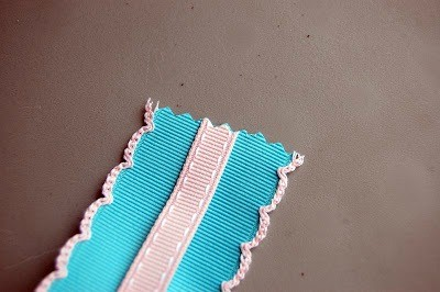 Cut your ribbons to the length needed. Over lap the smaller over the bigger one.