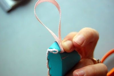 Put your loop on the ribbon and fold over twice to hide raw edge.