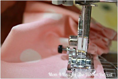 Start to sew a ruffle down the edge of the raw side.