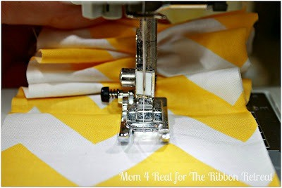 Cut two pieces of fabric and ruffle them down the center.