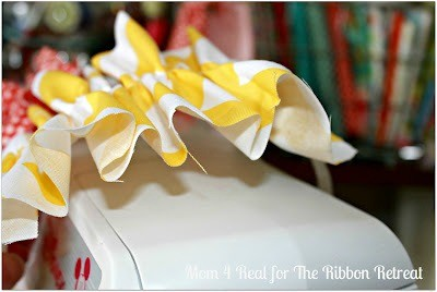Hot glue your ruffle to your headband. Put it towards the side.