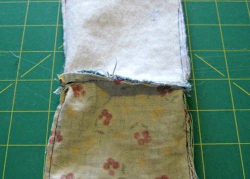 Pull the lining out of the outer fabric.