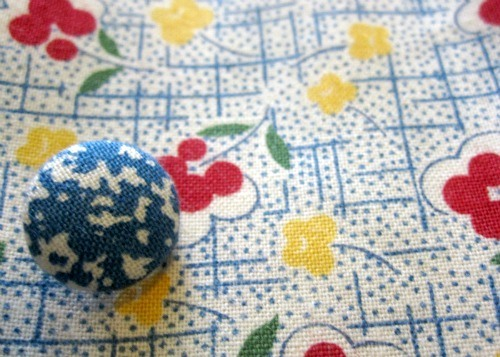 Make a fabric covered button using the directions on your kit.