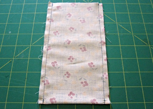 Adhere your fusible fleece on the outer fabric, then sew down both long sides.