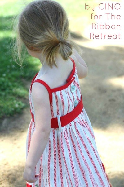 Summer dress with cute belt loops and sash and buttons!