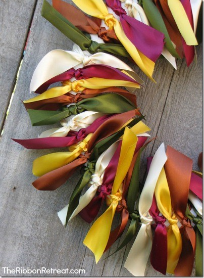 Knot beautiful satin ribbon around a wreath to make a beautiful accent piece.