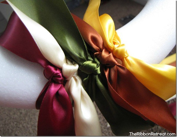 Tie your ribbon onto the wreath. Make sure the knots are made all the same way.