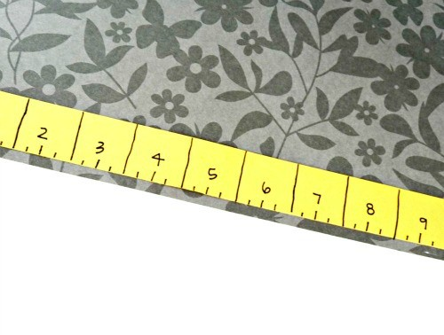 Cut your paper to fit the frame, make a ruler with measurements and place on paper.