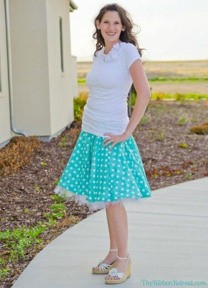 Model wearing a turquoise and white circle skirt.
