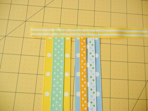 Continue gluing your ribbon strips on your long ribbon