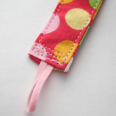 Sew a small square over the elastic end