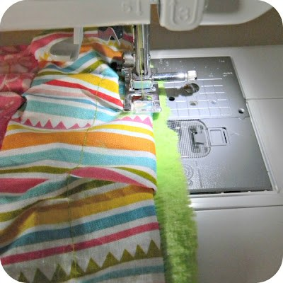 Fold in open edge, sew closed, top stitch around blanket