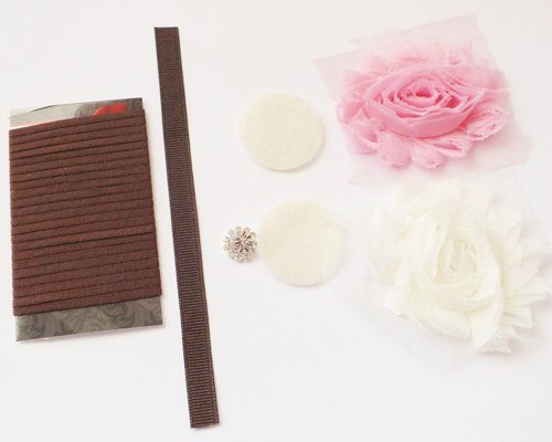 Materials for making a flower headband with skinny elastic.