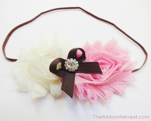Hot glue the little bow to your flowers for embellishment.