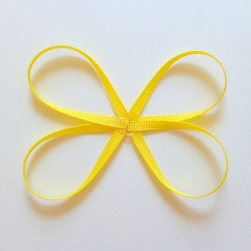 make a butterfly shape with your figure 8 ribbons
