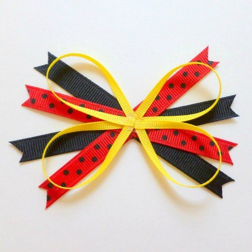 place butterfly shape on top of other x ribbons