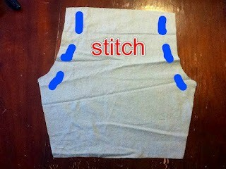 Lay pants together, right sides together and stitch sides to the crotch.