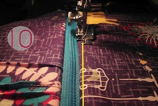 Press and top stitch along the zipper.